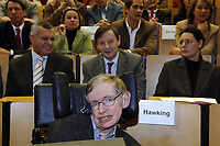 British physician Stephen Hawking sits in his wheelchair in an overcrowded lecture hall of the 'Freien Unversitaet' University Berlin, Germany, Monday 17 October 2005. Stephen Hawking lectured in the 'Einstein Lectures' programme. Credit: Steffen Kugler/DPA /MediaPunch ***FOR USA ONLY***