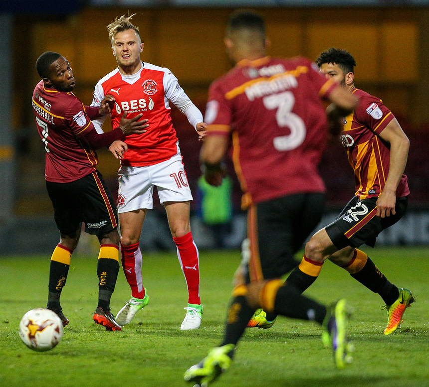 Fleetwood Town's David Ball gets a ball away under pressure from Bradford City's Mark Marshall<br /> <br /> Photographer Alex Dodd/CameraSport<br /> <br /> The EFL Sky Bet League One - Play-Off Semi-Final First Leg - Bradford City v Fleetwood Town - Thursday 4th May 2017 - Coral Windows Stadium - Bradford<br /> <br /> World Copyright &copy; 2017 CameraSport. All rights reserved. 43 Linden Ave. Countesthorpe. Leicester. England. LE8 5PG - Tel: +44 (0) 116 277 4147 - admin@camerasport.com - www.camerasport.com