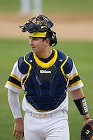 Michigan Wolverines catcher Harrison Wenson (45) in action during the NCAA baseball game against the Washington Huskies on February 16, 2014 at Bobcat Ballpark in San Marcos, Texas. The game went eight innings, before travel curfew ended the contest in a 7-7 tie. (Andrew Woolley/Four Seam Images)