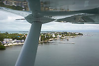 Belize, Central America - Morning flight in to Caye Caulker from Ambergris over the many private, wooden piers on the Caye Caulker waterfront.