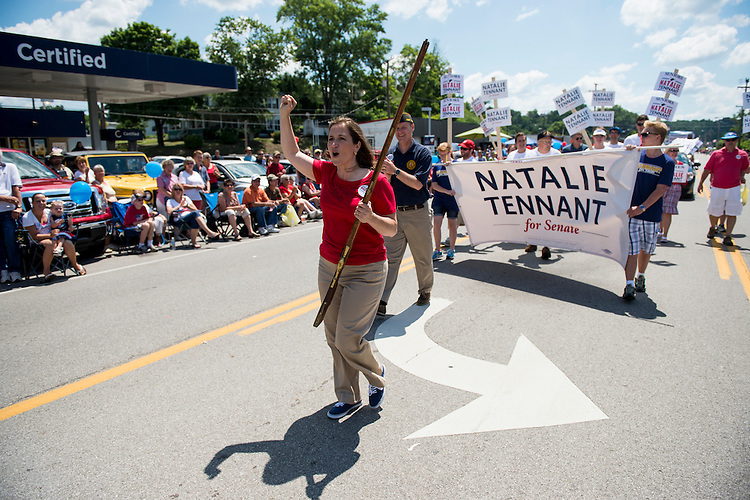 "UNITED STATES - JULY 4: U.S. Senate candidate West Virginia Secretary of State Natalie Tennant marches with her musket in the Ripley 4th of July Parade in Ripley, W. Va., on July 4, 2014. The parade is billed as ""the USA's largest small town Independence Day Celebration. Tennant was selected in 1990 as the first woman to represent the University of West Virginia as the Mountaineers' mascot.(Photo By Bill Clark/CQ Roll Call)"