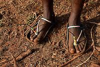 TANZANIA, Korogwe, Massai in Kwalukonge village, rubber sandals with antenna made from car tyre / TANSANIA, Korogwe, Massai im Dorf Kwalukonge, Sandalen aus Autoreifen