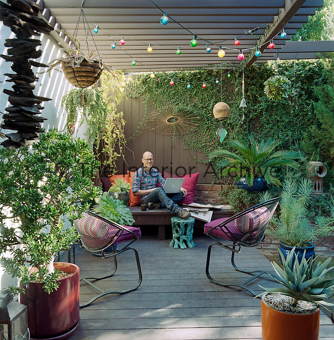 Steven Johanknecht at home in his courtyard garden