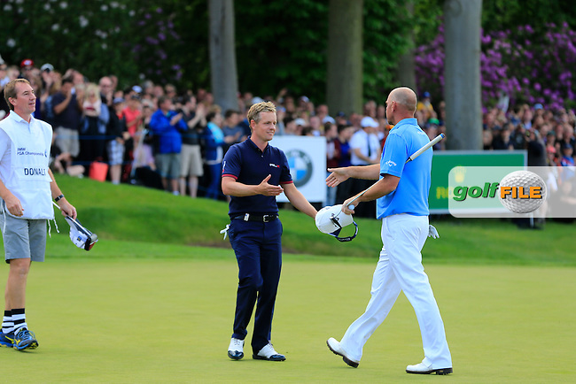 Luke Donald (ENG)(L) and Thomas BJORN (DEN)(R) during the final round of the BMW PGA championship, Wentworth Golf Club, Virginia Waters, London.<br /> Picture: Fran Caffrey www.golffile.ie