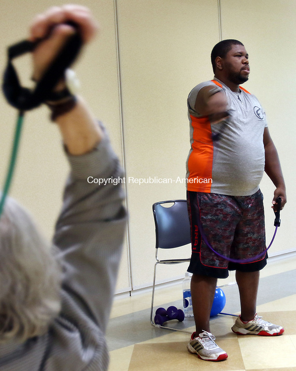 WOODBURY CT. 09 May 2017-050917SV02-Alex Weston instructs a Strength Training and Weights Class at the senior center in Woodbury Tuesday.<br /> Steven Valenti Republican-American