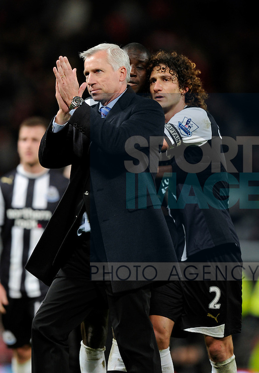 Alan Pardew manager of Newcastle United applauds the fans