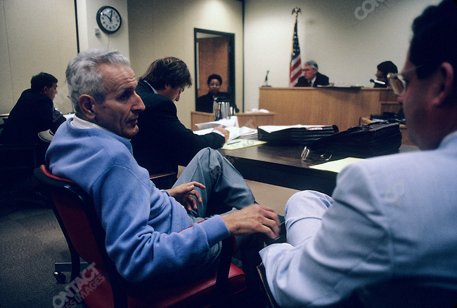 """Jack Kevorkian, MD, so called """"Dr Death"""" as a renowned advocate for assisted suicide in the early 1990s, talking to media in court, during a hearing on his actions. His attorney, Geoffrey Feiger, is to his left Detroit, Michigan, June 1992"""