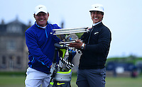 Thorbjorn Olesen of Denmark poses with his caddie Dominic Bott (L) and the trophy on the Swilcan Bridge following his victory during the Final Round of the 2015 Alfred Dunhill Links Championship at the Old Course, St Andrews, in Fife, Scotland on 4/10/15.<br /> Picture: Richard Martin-Roberts | Golffile