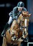 Philipp Weishaupt of Germany riding Carinou competes at the Hong Kong Jockey Club trophy during the Longines Hong Kong Masters 2015 at the AsiaWorld Expo on 13 February 2015 in Hong Kong, China. Photo by Juan Flor / Power Sport Images