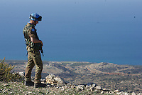 An Italian soldier from first Platoon, Montebello Squadron, Fifth  Lancieri of Novara regiment of the Italian Cavalry  provides security during  a routine patrol out of the UNIFIL Chama base in Southern Lebanon on Friday Dec 08 2006..Close to 1000 Italian peacekeepers operate in  the in Southern lebanon town of Chama, constantly patrolling their sector in search for illegal weapons in the country.