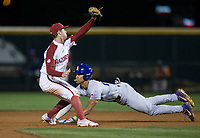 NWA Democrat-Gazette/BEN GOFF @NWABENGOFF<br /> CJ Willis of LSU slides in safe to steal second base ahead of a throw to Casey Martin, Arkansas shortstop, in the 7th inning Thursday, May 9, 2019, at Baum-Walker Stadium in Fayetteville.