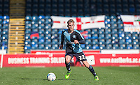 Jason McCarthy of Wycombe Wanderers looks for options during the Sky Bet League 2 match between Wycombe Wanderers and Barnet at Adams Park, High Wycombe, England on 16 April 2016. Photo by Andy Rowland.
