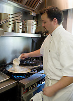 Chef Matt Regan Victorian Inn Lafiette New Orleans preparing a roux to make freah gumbo