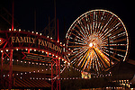 Ferris Wheel and the entrance to the Family Pavilion on Navy Pier lit up at night, Chicago, IL, USA