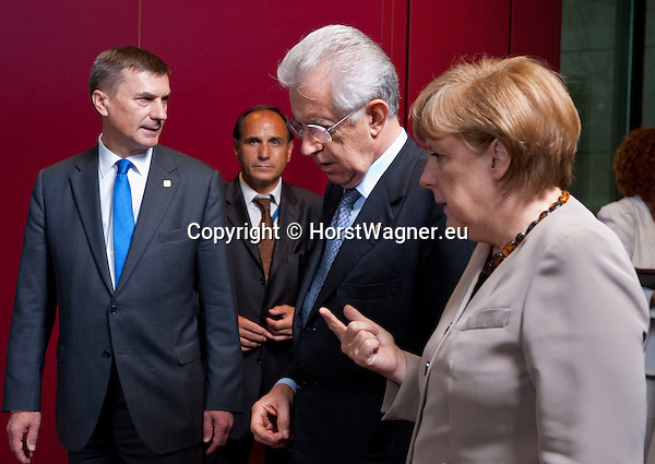 Brussels-Belgium - June 28, 2012 -- European Council, EU-summit meeting of Heads of State / Government; here, get-together for a family picture, Mario MONTI (ce), Prime Minister of Italy, with Angela MERKEL (ri), Federal Chancellor of Germany; Andrus ANSIP (le), Prime Minister of Estonia, following them  -- Photo: © HorstWagner.eu