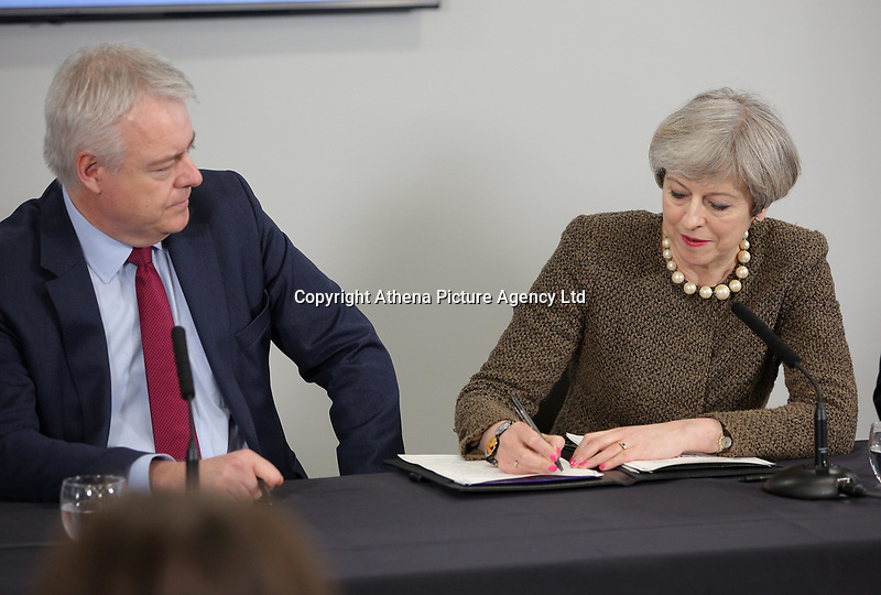British Prime Minister Theresa May (R) signs alongside First Minister for Wales Carwyn Jones, the Bay City Region deal, at the Liberty Stadium, Swansea, Wales, UK. Monday 20 March 2017.