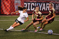 Penn's Maya Lacognato (12) looses her footing while playing a ball into the box in front of Brebeuf Jesuit's Lizzy Case (9) and Alia Martin (23) during the IHSAA Class 2A Girls Soccer State Championship Game on Saturday, Oct. 29, 2016, at Carroll Stadium in Indianapolis. Special to the Tribune/JAMES BROSHER
