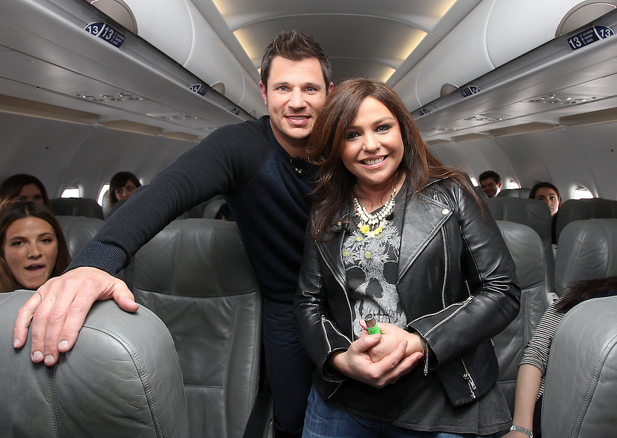 "Host Nick Lachey and TV personality Rachel Ray are seen on the  VH1's ""Big Morning Buzz Live"" JetBlue flight to SXSW on Wednesday, March 18, 2015, in New York. (Photo by Donald Traill/Invision/AP)"