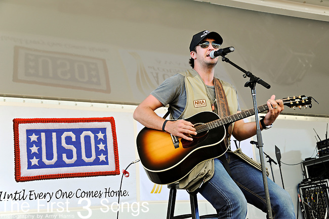 Luke Bryan performs during the ACM / USO Concert Event on Nellis Air Force Base in Las Vegas, Nevada on April 2, 2011.