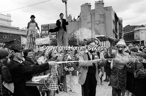 Opening of the new Covent Garden Piazza London by street artists from the Covent Garden Community Association wearing Sir Horace Cutler masques cut the opening ceremony spoof tape . 19 June 1980...