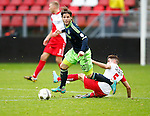 Nederland, Utrecht, 23 december 2012.Eredivisie .Seizoen 2012-2013.FC Utrecht-Ajax.Lasse Schone (2e van links.) van Ajax passeert Michael Zullo (r.) van FC Utrecht.