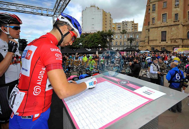 Maglia Rossa wearer Nacer Bouhanni (FRA) FDJ.fr signs on before the start of the Stage 5 of the 2014 Giro d'Italia, a 203km hilly stage running from Taranto to Viggiano, Italy.11th May 2014.<br />