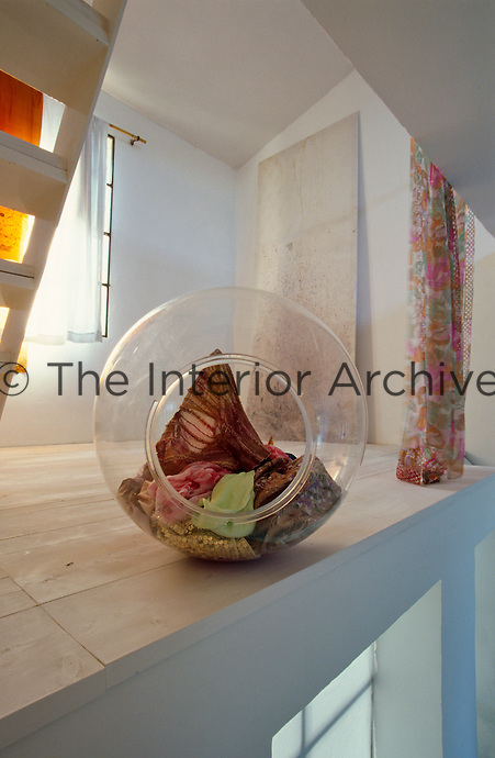 A collection of coloured fabrics in an overturned glass bowl on the mezzanine