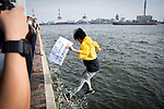 JUNE 28, 2019 - A protestor from Hong Kong jumped into Osaka Bay, near the site of the G20 Summit in Osaka, Japan. Protestors were trying to draw attention to legislation that would allow Hong Kong residents to be extradited to face trial in mainland China. (Photo by Ben Weller/AFLO) (JAPAN) [UHU]