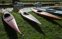 26 MAY 2013 - BRIGG, GBR - Kayaks lie on the grass for the start of the kayak leg of the 2013 Brigg Bomber Quadrathlon, a World Quadrathlon Federation World Cup round and the British Championships, held in Brigg in Lincolnshire, Great Britain .(PHOTO (C) 2013 NIGEL FARROW)