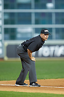 Umpire Michael Banks works the third base line during the NCAA baseball game between the Missouri Tigers and the Texas Longhorns in game eight of the 2020 Shriners Hospitals for Children College Classic at Minute Maid Park on March 1, 2020 in Houston, Texas. The Tigers defeated the Longhorns 9-8. (Brian Westerholt/Four Seam Images)