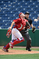 Clearwater Threshers catcher Chad Carman (18) chases down a foul pop up in front of umpire Mike Wiseman during a game against the Dunedin Blue Jays on April 6, 2014 at Bright House Field in Clearwater, Florida.  Dunedin defeated Clearwater 5-2.  (Mike Janes/Four Seam Images)