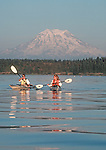 Sea kayakers, Mount Rainier, Puget Sound, Washington State, Pacific Northwest, Nisqually Reach, Models: Karen Reed, Mary Van Cline, Released.