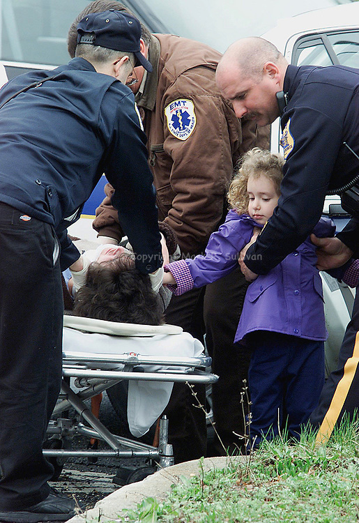 MVA)--22044--On Thur Apr 12,2001--A young girl reaches out to her mother (?????) as the women lays on a strecher after the two were in one of the two vehicles involved in an mva that occured at the corner of Cranbury Rd. & Dunhams Corner Rd, in East Brunswick. The mva occured about 11:45 am and there were at least three injuries, after a transportation van hit a sports utility vehicle from behind and forced it into the traffic pole at the corner. (MARK R. SULLIVAN/HNT CHIEF PHOTOGRAPHER)
