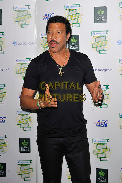 Lionel Richie <br /> Barclaycard British Summertime, Hyde Park, London, England. <br /> 14th July 2013<br /> half length black t-shirt hands arms necklace cross crucifix moustache mustache facial hair<br /> CAP/MAR<br /> &copy; Martin Harris/Capital Pictures