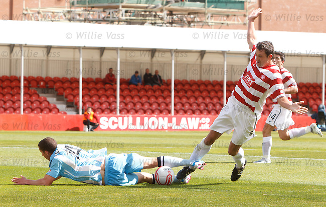 Martin Canning brings down Calum Elliot for a Hearts penalty and a straight red card
