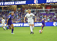 Orlando, FL - Saturday March 24, 2018: Utah Royals Gunnhildur Jonsdottir (23) plays the ball away from Orlando Pride midfielder Dani Weatherholt (17) during a regular season National Women's Soccer League (NWSL) match between the Orlando Pride and the Utah Royals FC at Orlando City Stadium. The game ended in a 1-1 draw.