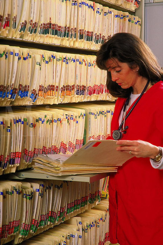 Nurse examines records