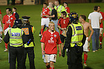 Barnsley 0 Huddersfield Town 1, 12/05/2006. Oakwell, League One Play Off Semi Final 1st Leg. Barnsley (red shirts) versus Huddersfield Town, Coca-Cola League One play-off semi-final first leg at Oakwell, Barnsley. The visitors won one-nil with a goal from Gary Taylor-Fletcher in 85 minutes. Picture shows Barnsley's Bobby Hassell makes his way through the police lines at the end of the match. Photo by Colin McPherson.