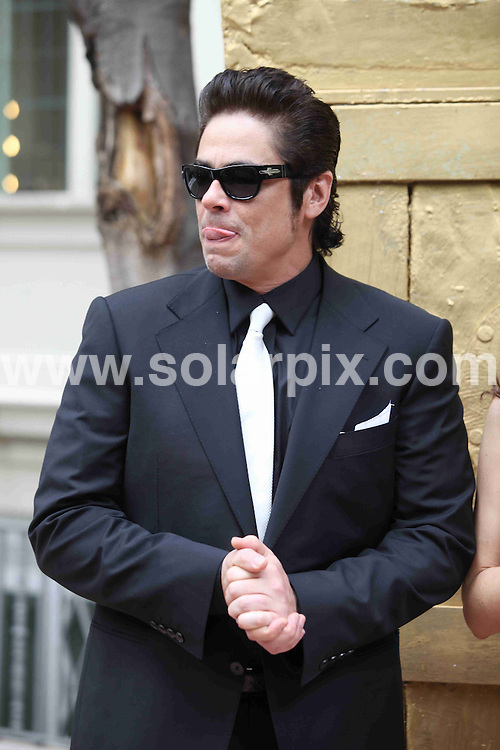 **ALL ROUND PICTURES FROM SOLARPIX.COM**.**WORLDWIDE SYNDICATION RIGHTS**NO PUBLICATION IN SPAIN**.Actor Benicio del Toro and actress Caroline Correa present the new Magnum Gold Ice Cream at the El Principal restaurant, Barcelona, Spain. 8 April 2010..This pic: Benicio del Toro..JOB REF: 11074 MER       DATE: 08_04_2010.**MUST CREDIT SOLARPIX.COM OR DOUBLE FEE WILL BE CHARGED**.**MUST NOTIFY SOLARPIX OF ONLINE USAGE**.**CALL US ON: +34 952 811 768 or LOW RATE FROM UK 0844 617 7637**