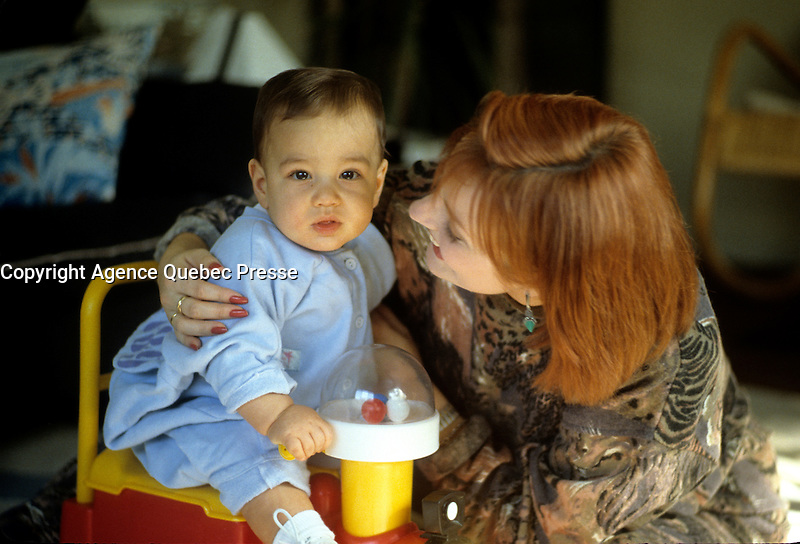 EXCLUSIVE FILE PHOTO :  <br /> <br /> Quatre saisons TV Host Claire Caron and her baby in her house, circa 1987 (exact date unknown)<br /> <br /> <br /> Photo :  Pierre Roussel  - Agence Quebec Presse