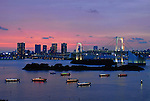"With Rainbow Bridge and the,  downtown city skyline in the background""Yakata-bune"" pleasure boats set anchor on the placid waters of the Daiba area of Tokyo Bay in Tokyo, Japan on 3 Sept.  2010. .Photographer: Rob Gilhooly"