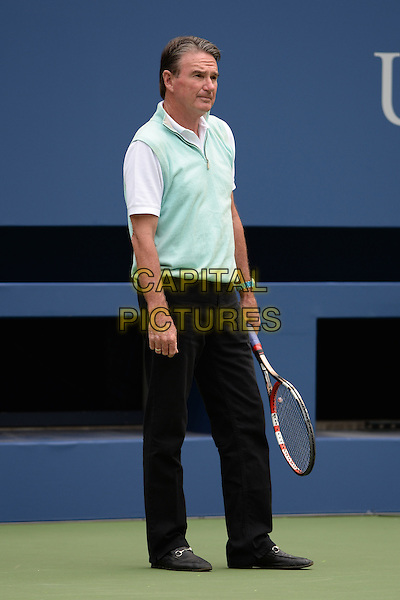 FLUSHING NY- AUGUST 30: Jimmy Connors on the practice court with Eugenie Bouchard at the USTA Billie Jean King National Tennis Center on August 30, 2015 in Flushing Queens. <br /> CAP/MPI/MPI04<br /> &copy;MPI04/MPI/Capital Pictures