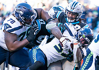 CHARLOTTE, NC - DECEMBER 15: Chris Carson #32 of the Seattle Seahawks crosses the goal line for a touchdown during a game between Seattle Seahawks and Carolina Panthers at Bank of America Stadium on December 15, 2019 in Charlotte, North Carolina.