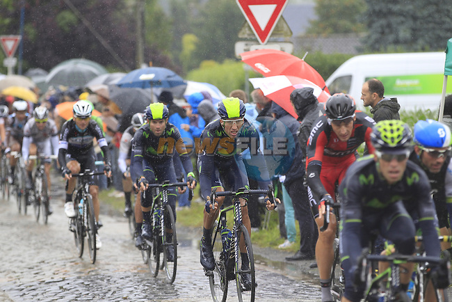 Movistar Team riders tackle the1st cobbled sector 9 from Gruson to Crossroads de l'Arbe during Stage 5 of the 2014 Tour de France running 155.5km from Ypres to Arenberg. 9th July 2014.<br /> Picture: Eoin Clarke www.newsfile.ie