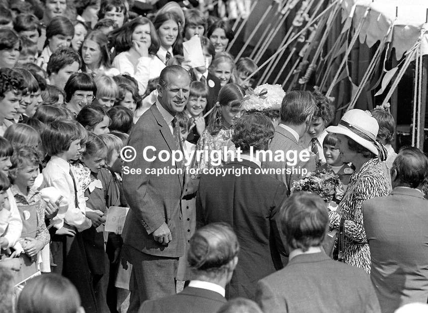 A relaxed Duke of Edinburgh, who accompanied Queen Elizabeth II on her Silver Jubilee visit to N Ireland mingles with guests at a garden party at Hillsborough Castle, the queen's official residence whilst visiting the Province. 197708100074S<br />