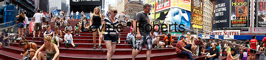 People relax on the red stairs behind the TKTS booth at Times Square in New York on Thursday, June 28, 2012.  (© Frances M. Roberts))