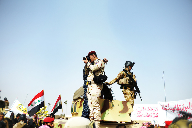 Iraqi Military photograph demonstrators. Ramadi, IRAQ: ..An Iraqi military policemen photographed demonstrators during anti-government demonstration  in Iraq's Anbar province. ..Once occupied by American troops, the country today looks increasingly occupied by an authoritarian Iraqi military...