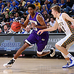 SIOUX FALLS, SD - MARCH 7: Dalan Ancrum #15 of Western Illinois drives against Cory Jacobsen #13 in the second half of the first round of the men's Summit League Championship Tournament game Saturday evening at the Denny Sanford Premier Center in Sioux Falls, SD. (Photo by Dave Eggen/Inertia)