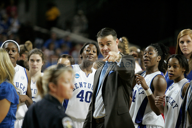 The Kentucky Women's basketball team celebrates after defeating the Liberty Flames in the first round of NCAA tournament play at Freedom Hall on Saturday, March 20, 2010. Photo by Scott Hannigan | Staff