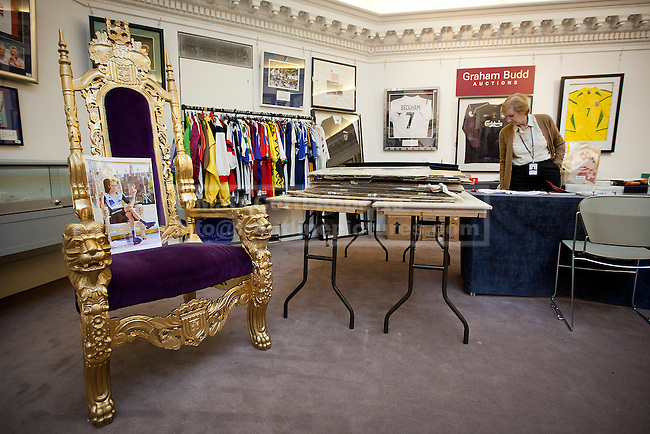 06/11/2012. London, UK. The throne in which gold medal winning cyclist Bradley Wiggin sat after winning the men's cycling time trial during the 2012 London Olympic Games is seen at Sotheby's Grosvenor Galleries in London after failing to meet its reserve at a sporting memorabilia auction today (06/11/12).  The auction, held at Sotheby's New Bond Street Auction House, saw a reserve of GB£10,000 reserve placed on the chair which was estimated to fetch GB£10,000-15,000 although the throne only commanded a highest bid of GB£9,500.  Photo credit: Matt Cetti-Roberts